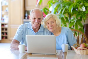 © Cromary   Dreamstime.com - Senior Couple Using Laptop At Home Photo