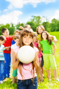 © Serrnovik | Dreamstime.com - Girl With Ball And Her Team Photo