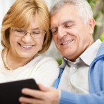 coppia-senior-tablet © Milanmarkovic | Dreamstime.com - Senior Couple Using Tablet PC Photo